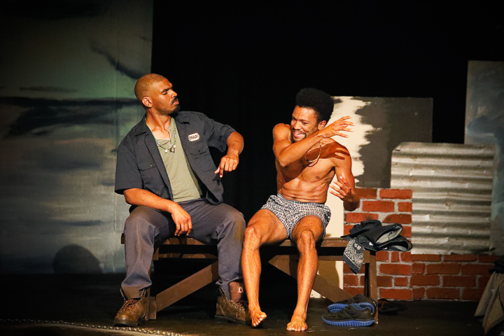 Pictured left to right: LaKeidrick Wimberly as Ogun and Gabriel Christian as Oshoosi in Tarrel Alvin McCraney's THE BROTHERS SIZE, directed by Darryl V. Jones A Theatre Rhinoceros Production at the Eureka Theatre; photo by Steven Ho.