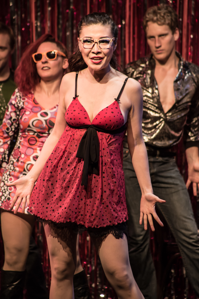 Pictured L to R: David Tuttle as Pop Musik Dancer 1, Dee Wagner as Pop Musik Dancer 2, Grace Liu as Cynthia and Morgan Lange as Pop Musik Dancer 3 in PRISCILLA, QUEEN OF THE DESERT, The Musical; Directed by John Fisher; A Theater Rhinoceros Production at the Gateway Theatre. Photo By David Wilson. *Member, Actors' Equity Association