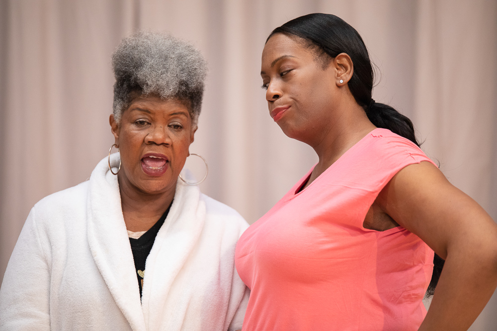 Pictured L to R: Shirley Smallwood as Carolyn and Cece Suazo as Veronika in Chisa Hutchinson's DEAD AND BREATHING, Directed by AeJay Mitchell; A Theatre Rhinoceros Production at the Gateway Theatre. Photo by Steven Ho.