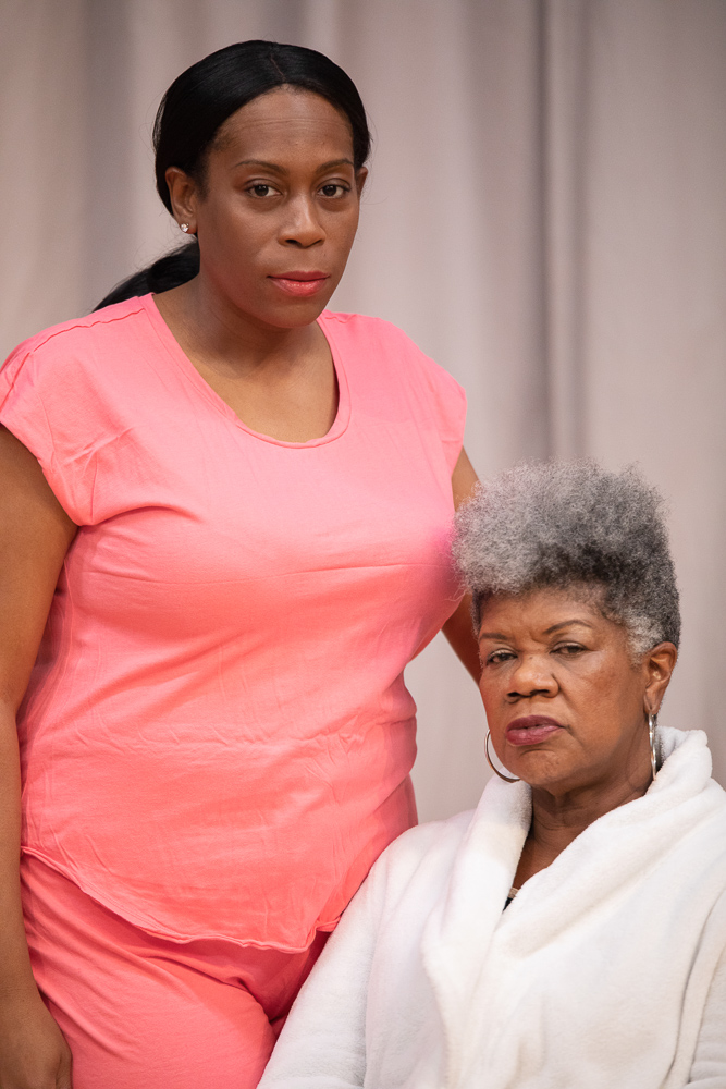 Pictured L to R: Cece Suazo as Veronika and Shirley Smallwood as Carolyn in Chisa Hutchinson's DEAD AND BREATHING, Directed by AeJay Mitchell; A Theatre Rhinoceros Production at the Gateway Theatre. Photo by Steven Ho.