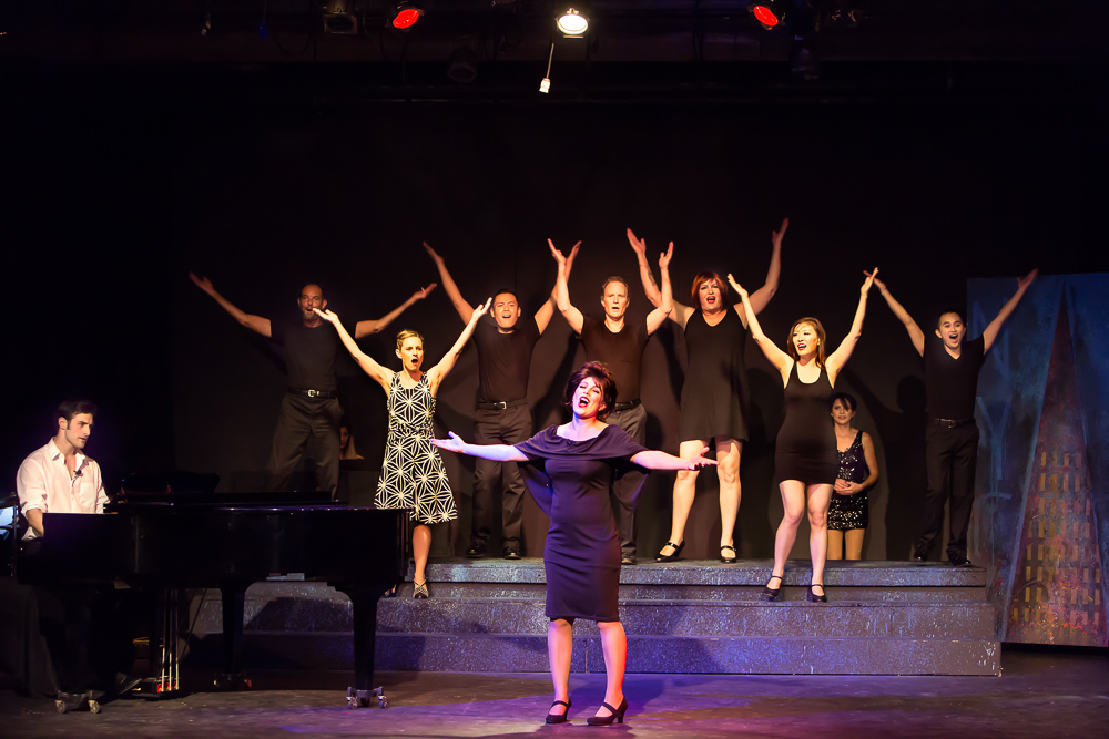 Pictured L to R: Justin Genna* as Peter Allen, Kim Larsen as Dick, Larissa Kelloway as Marion, Justin Lopez as Greg, Leandra Ramm as Judy Garland, John-Thomas Hanson as Mark, SuzyJane Edwards as Dee, Grace Chen as Rockie, Carole Ann Walker as Liza Minnelli and John Charles Quimpo as Chris in THE BOY FROM OZ, directed by John Fisher; a Theatre Rhinoceros Production at The Gateway Theatre. Photo by David Wilson.